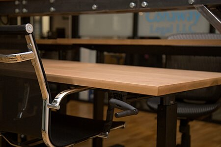 Sit-stand desk at The Mill coworking space